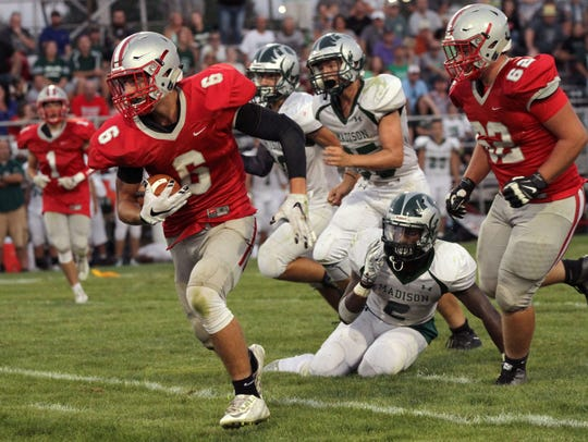 Shelby's Hunter Egner runs to the end zone while playing