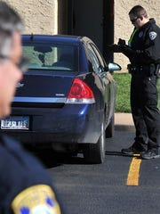 Wichita Falls police search a vehicle that was suspected