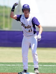 Wylie first baseman Tyler Spears (41) signals to the dugout following a two-run double during the third inning of the Bulldogs' 12-8 win against Graham in Game 2 of the Region I-4A bi-district series at Bulldog Field on Saturday, May 5, 2018. Wylie won Game 3, 9-5.