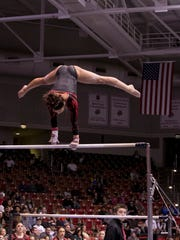 SUU's Jamie Armijo performs on the bars against Arizona State on Friday in Centrum Arena. Armijo scored a 9.9 as SUU took five of the top six spots in the event.
