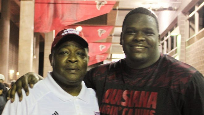 Chuck Gordon, left, and his son, UL center Eddie Gordon, right