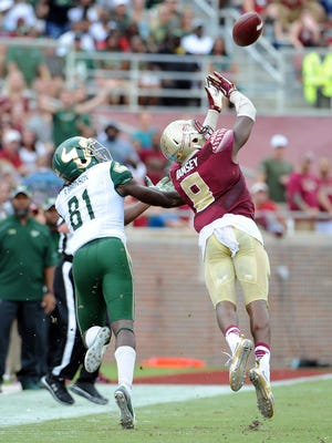 Jalen Ramsey nearly intercepts a ball as FSU defeats USF 34-14.
