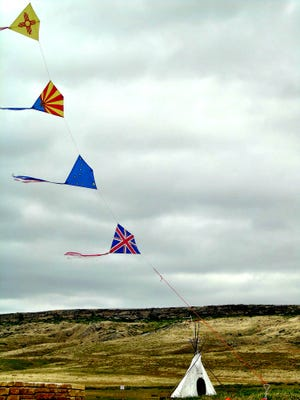 Kites fly at the annual Buffalo Kite Festival at First Peoples Buffalo Jump State Park on Saturday. The event continues 10-4, Sunday, July 15 .