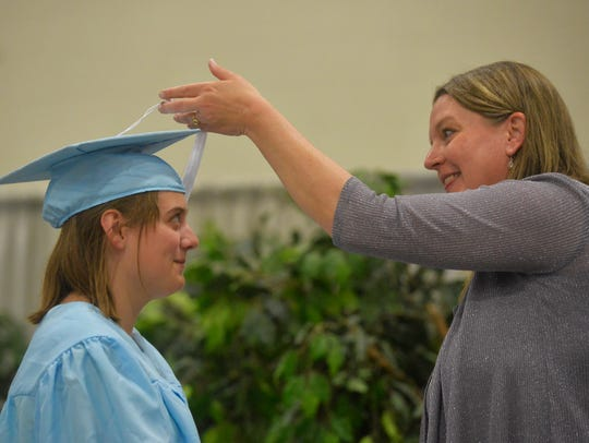 Great Falls High principal Heather Hoyer congratulates her graduates and turns over their tassels during the Class of 2018 commencement ceremony on Sunday, May 27, 2018, in the Four Seasons Arena.
