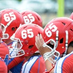 Jackson Prep players wore the number 65 on their helmets during their game at Copiah Academy in August 2014 in memory of player Walker Wilbanks who died after falling ill during a game the previous week. Two Louisiana congressmen have introduced a bipartisan bill calling for a study into football players' deaths.