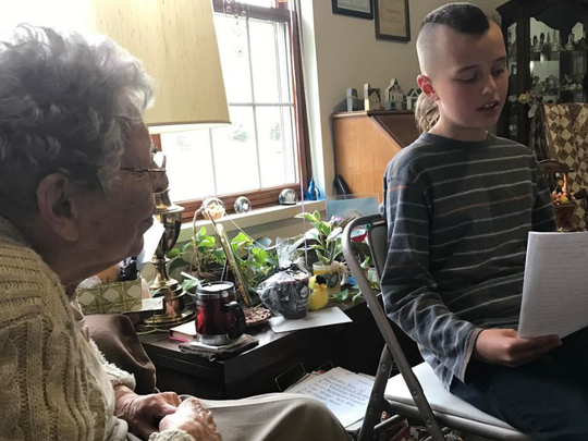 Two Rivers fifth-grade student Blaise Kriese shares his letter with Miriam Olmsted.