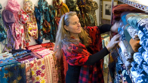 Pattiy Torno, owner of the Curve Studios & Garden, looks through her material. She is a fiber artist.