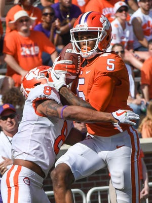 Clemson wide receiver Tee Higgins (5) catches a ball near Clemson defensive back A.J. Terrell (8) during the 3rd quarter of the spring game in Memorial Stadium in Clemson on Saturday, April 14, 2018.