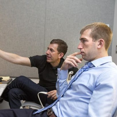 ESPN senior coordinating producer Gerry Matalon, left, works with former Purdue forward Robbie Hummel during the NBPA's Sportscaster U program.