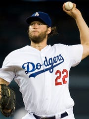 Los Angeles Dodgers' Clayton Kershaw will start the National League Division Series playoff opener against the St. Louis Cardinals on Friday.