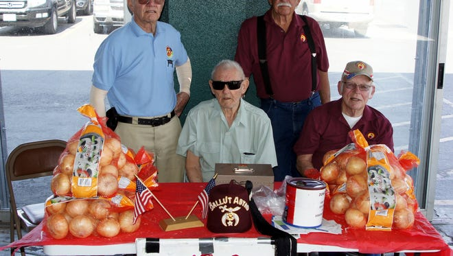 Members of the Deming Shrine Club have been selling Bill Johnson's Farm Sweet Carzalia Onions in front of Peppers Supermarket this week. The onions are being sold in 10-pound bags for a $10 donation. All of the money raised through the sales will help children who need services from the many Shrine hospitals across the country. The Shriners on duty this week were, from left, J.D. Gray, Dick Hamilton, Wayland Wliis and Bob Speer.