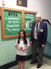 Congratulations to St. Francis Cathedral School fourth grade student,  Alexa Menziuso who won 3rd place at the state level for the American  Legion Coloring Contest.  She is pictured here as she accepts her medal  from  Walter Zjawin, American Legion Post 65.