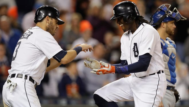 Tigers centerfielder Cameron Maybin, right, and second baseman Ian Kinsler celebrate after Maybin's two-run homer Friday at Comerica Park.