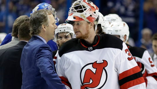 New Jersey Devils goaltender Cory Schneider, right,