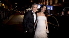 George Clooney and Amal Clooney arrive at the Cesar