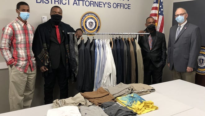 Plymouth County District Attorney Timothy Cruz, right, and his office's employees donated suits and other clothing to Brockton community organization PACC, which stands for People Affecting Community Change, on Wednesday, Oct. 7, 2020.
