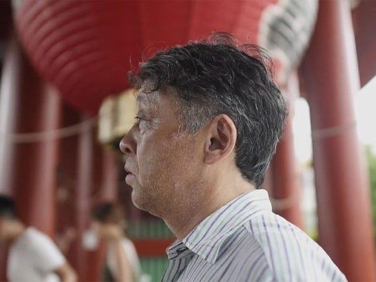 A profile image of Nobuo Fukuda is captured in a scene
