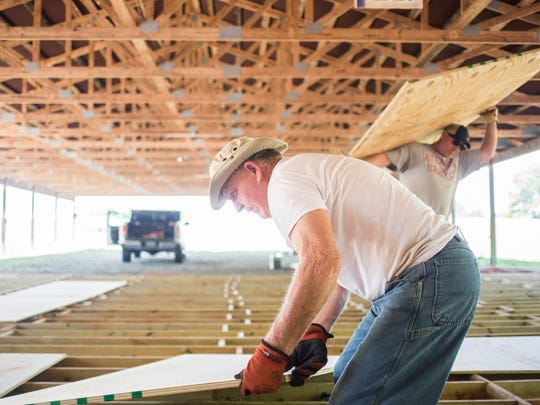 Duane Jenkins works on the new Blue Jar Barn on Thursday in Anderson.