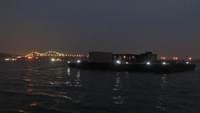 A construction barge is moored at night in the Hudson River north of the Tappan Zee Bridge on Sept. 11.