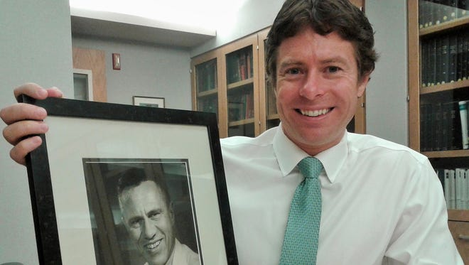 The long surgical and medical legacy of the Buckwalter family in this area continues with the recent arrival of Jody Buckwalter, who has joined the University of Iowa faculty as an orthopedic surgeon.  He holds a photo of his grandfather, Joseph Addison Buckwalter III, a surgical pioneer here from the 1940s.