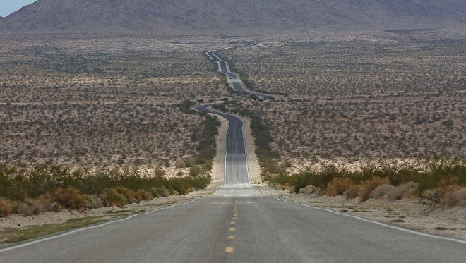 Highway 62 cuts through the Mojave Desert, Wednesday, October 8, 2014.