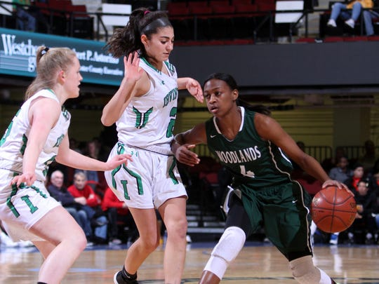 Woodlands' Teisha Hyman (right) is guarded by Irvington's Olivia Valdes (middle) and Lindsay Halpin (left) during a Section 1 Class B semifinal basketball game at the Westchester County Center Feb. 28, 2017.
