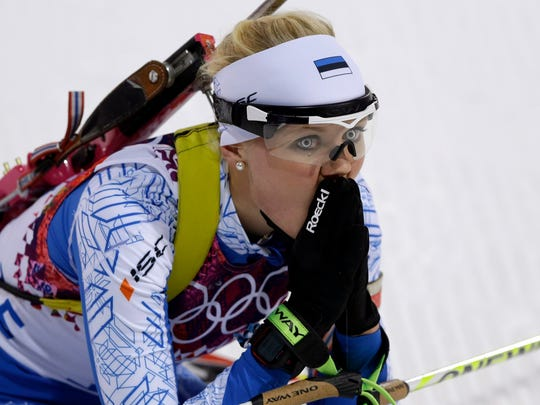 Estonia's Grete Gaim looks up after completing the women's biathlon 7.5k sprint.