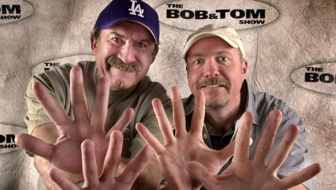 Bob Kevoian (left) and Tom Griswold are shown holding up 20 fingers for the 20th anniversary of the show back in 2003.