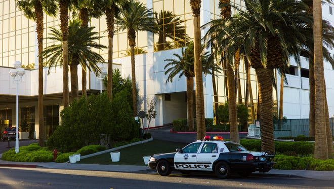 A Las Vegas police squad car sits outside of the Trump International Hotel after two separate fires were started at the hotel in Las Vegas on Wednesday, April 26, 2017.
