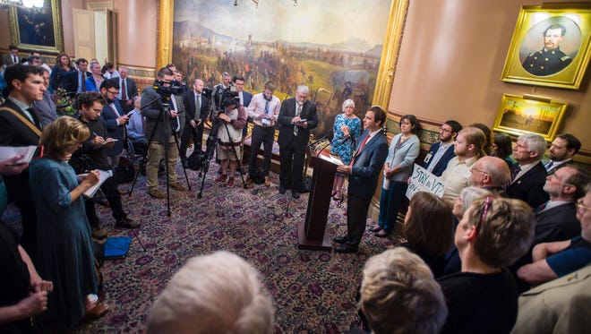 Senate President Pro Tempore Tim Ashe, D/P-Chittenden, right, joined by Speaker of the House Mitzi Johnson, D-South Hero, speaks at a press conference in May 2018, after Gov. Phil Scott had vetoed a paid family leave bill. Lawmakers are pitching a new version of the bill this year.