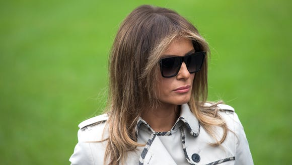First Lady Melania Trump dons shades and a trench on