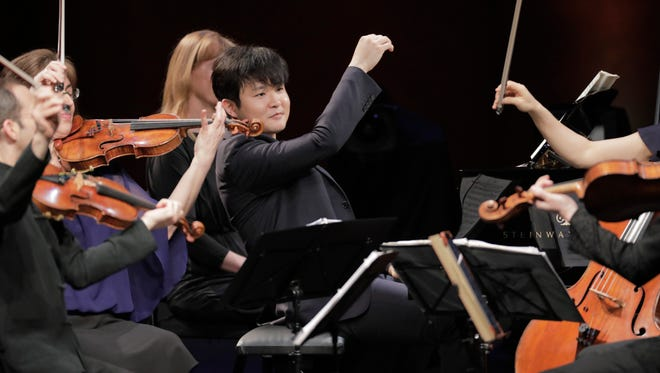 Yekwon Sunwoo from South Korea performs with the Brentano String Quartet on Wednesday in the Final Round of The Fifteenth Van Cliburn International Piano Competition held at Bass Performance Hall in Fort Worth, Texas.