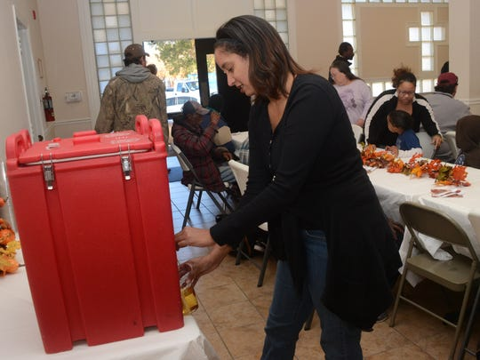 Terese White, a Delta flight attendant from Atlanta, helped serve Thanksgiving Dinner on Thursday for the Salvation Army.