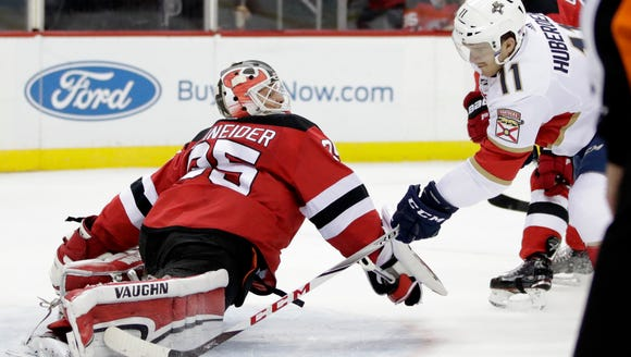 New Jersey Devils goalie Cory Schneider (35) blocks