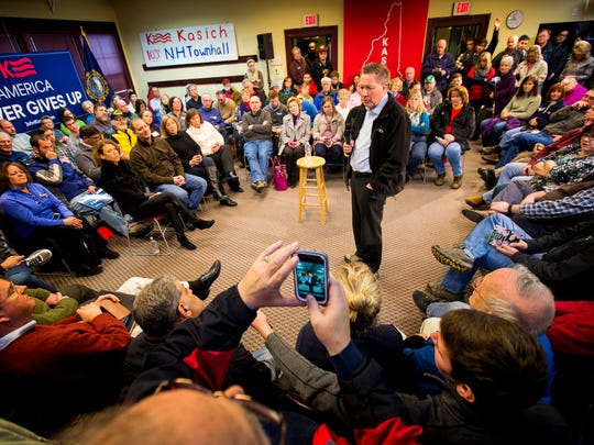 Gov. John Kasich answers questions at a town hall at Plaistow Public Library  in Plaistow, N.H. on Monday, Feb. 8, 2016.
