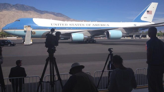 Members of the press set up for President Barack Obama's departure on Air Force One at Palm Springs International Airport on Monday.