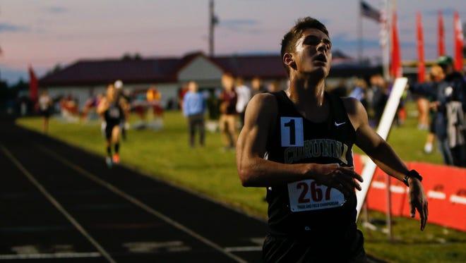 Corunna senior Noah Jacobs runs a 9:17.55 in the 3200 meter run Tuesday, May 30, 2017, during the 2017 Honor Roll Meet at Sexton High School.