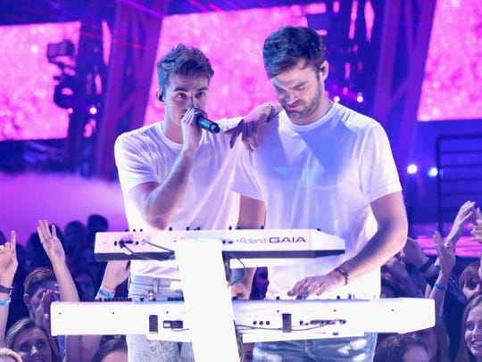 The Chainsmokers performing live.
