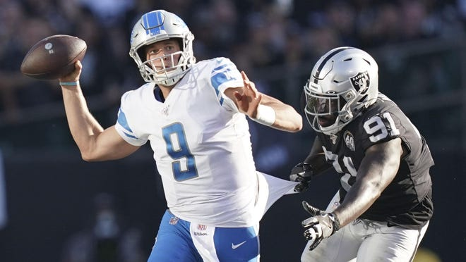 November 3, 2019; Oakland, CA, USA; Detroit Lions quarterback Matthew Stafford (9) is pressured by Oakland Raiders defensive end Benson Mayowa (91) during the fourth quarter at Oakland Coliseum. Mandatory Credit: Kyle Terada-USA TODAY Sports