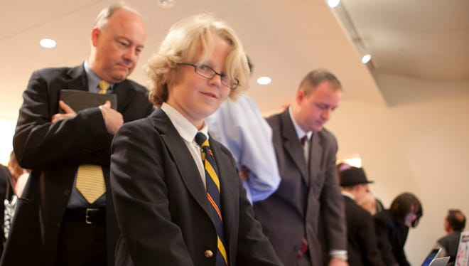 Cooper Kelley of Cambridge, MA shows off his National STEM Video Game Challenge winning game at an event at the Smithsonian American Art Museum recognizing the winners of the 2012 National STEM Video Game Challenge.