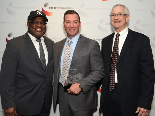 Casey Family Programs gives DCS Director Greg McKay a leadership award. From left to right, Casey Family Programs President and CEO, Dr. William C. Bell, DCS Director Greg McKay, and David C. Mills, Board Chair of Casey Family Programs.