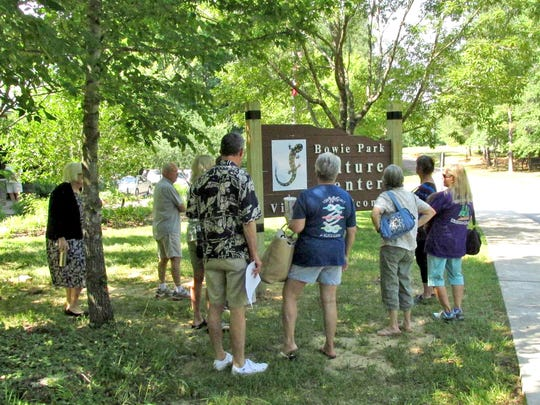 Friends of Bowie Nature Park look over the new sign