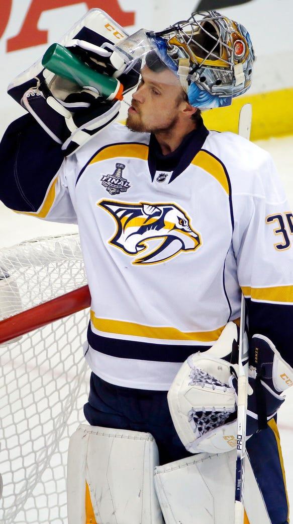 Nashville Predators goalie Pekka Rinne takes a drink