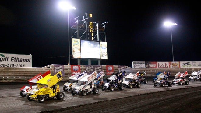 The C Main groups up at the start after the first rain delay at the Knoxville Nationals auto race, Saturday, Aug. 15, 2009, in Knoxville, Iowa. (AP Photo/Conrad Schmidt)
