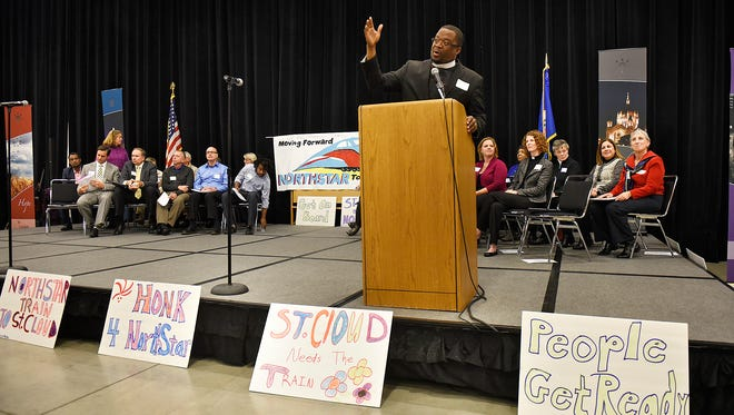 The Rev. James Alberts II speaks during a GRIP/ISAIAH event Thursday at the River's Edge Convention Center in support of extending the Northstar Commuter Rail line to St. Cloud.