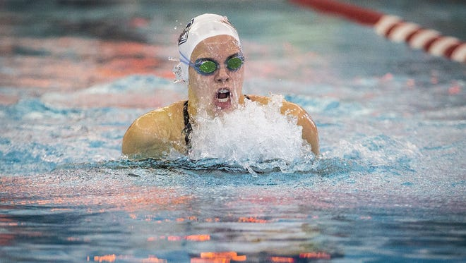 Jay County's Alex Bader competes in the 100-meter breaststroke during swimming sectionals at Jay County High School Saturday, Feb. 4, 2017.