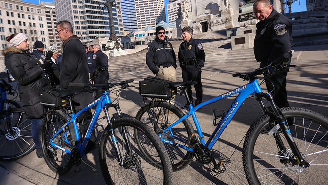 Officers from Indianapolis Metropolitan Police Department stand with new mountain bikes on Monument Circle, Indianapolis, Tuesday morning, March 14, 2017. Downtown Indy presented five bicycles to IMPD's Flex Team/Homeless Unit, which will provide access to rougher terrain, such as riverbanks or homeless camps.