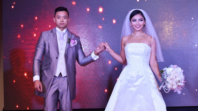 Eugene Bondoc and Carmen Cabrera model during the 2016 Weddings in Paradise Show at Lotte Hotel Guam in Tumon on March 19.