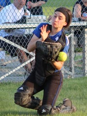 Ladywood's junior catcher Bridget Polk attempts to track down a foul ball near the fence in Friday's Catholic League loss to Farmington Mercy.