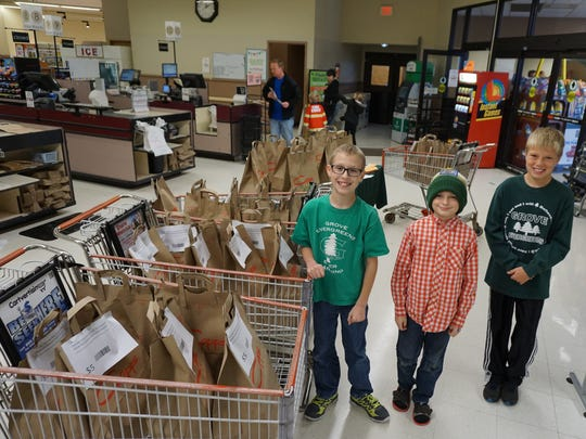 Grove Elementary School fifth-graders collected more than 1,000 food items to help those in need.